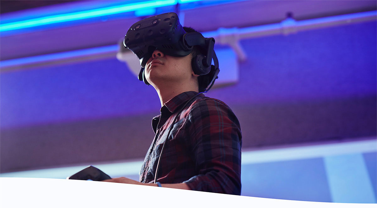 Pictured is a Holberton SF student playing with an Oculus VR headset
