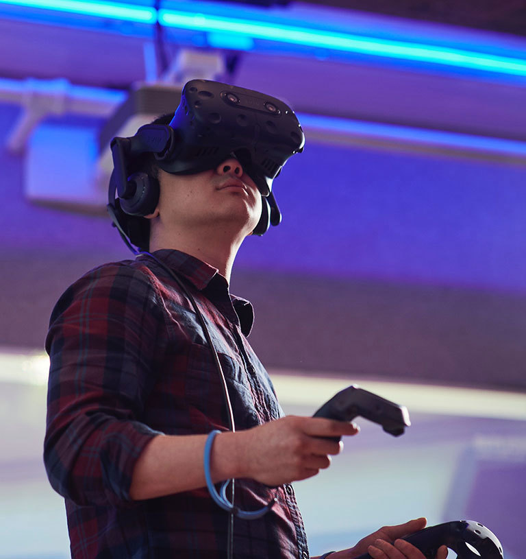 Pictured is a student experimenting with an Oculus VR headset
